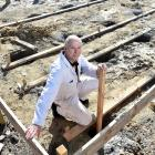 Dunedin City Petanque club president Phillip Lyall is surrounded by holes that are supposed to...