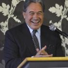 NZ First leader Winston Peters laughs in front of his audience in Dunedin yesterday. Photo:...