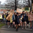 Hundreds marched across the campus in opposition to a plan cut staff and papers at the School of...