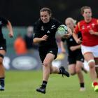 Selica Winiata on her way to scoring one of her three tries against Wales. Photo: Getty Images