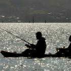 Salmon fishers try their luck on Otago Harbour. Photo: Stephen Jaquiery
