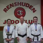 Renshuden Judo Club coach Ron Williams (centre) with members Alaina Baker (left) and Dylan...