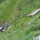 The dog kennel cage was ripped off its foundations and flung down a bank. Photo: Supplied