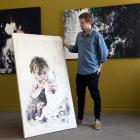 Tyler Kennedy Stent with a painting of one of the younger member's of Mai-Lee's family. Photo:...