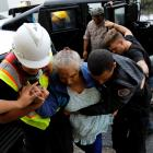 Rescue workers help a woman into the Emergency Operation Centre in Guayama, Puerto Rico after the...
