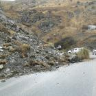 The Crown Range Rd is expected to reopen today after about 300cum of material slipped about 2.5km...