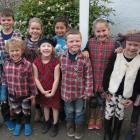 Roxburgh Area School junior pupils show some Scottish spirit as they dress for yesterday's...