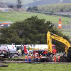 New Zealand Refinery staff at the site of a fuel pipeline leak on farm land between State Highway...
