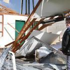 Te Runanga o Ngai Tahu chairwoman Lisa Tumahia examines the damage to Arahura Pa's former kohanga...