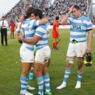 Argentina players Juan Martin Hernandez and Matias Orlando react after their loss to the...