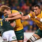 Ned Hanigan of Australia gets tackled by Jaco Kriel of South Africa during The Rugby Championship...