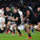 All Blacks first five-eighth Beauden Barrett runs the ball in the team's last meeting against...