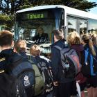 Tahuna Intermediate School pupils queue to board the Go Bus service to Portobello. Photo: Peter...