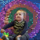 Espen Stringer-Shaw (2½), of Dunedin, with a sequin board which shows the effect of sound waves...