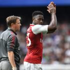 Danny Welbeck leaves the field with injury in Arsenal's game against Chelsea at the weekend....