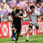 Retiring New Zealand sevens player DJ Forbes makes a break against Japan in Hong Kong earlier...