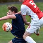 Ferrymead player Hikolai Molijn braces himself for the challenge from Caversham's Sam Cosgrave...