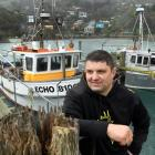 Dunedin fisherman and special innovation award winner Gavin Heineman with his boat Echo in Careys...