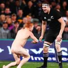 Brodie Retallick faces the streaker who ran on to the field during the game. Photo: Getty Images