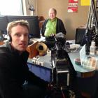 Director Grant Findlay filming the first frames of Radio Dunedin: The Documentary with veteran...