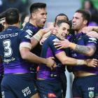 Melbourne Storm players celebrate a Billy Slater try in their qualifying final against the...