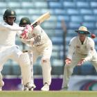 Mushfiqur Rahim plays the ball through the leg side for Bangladesh on the opening day of the...