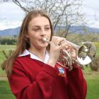 Dunstan High School pupil Sarah Wright plays a few notes on the cornet at her Galloway home....