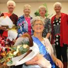Alexandra Blossom Festival Senior Queen Esther McKay takes her throne yesterday in front of other...