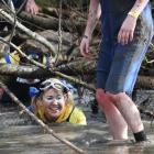 Ruby Ryan, of Otautau, gets down and dirty in last year's inaugural Clutha Mud Trudge, which this...