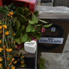 Flowers and tributes sit on the letterbox of the Nutsford St flat where a man's body was...