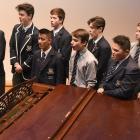 Otago Boys' High School pianist Sean Woo (16) accompanies fellow choir members (from left) Oban...