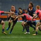 Otago replacement loose forward Sione Teu charges for the line to score in his side's clash...