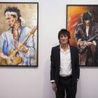 Rolling Stones guitarist Ronnie Wood with his art. Photo: Reuters