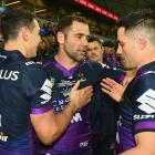 Billy Slater, Cameron Smith and Cooper Cronk celebrate their qualifying final win over the...