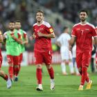 Syria players celebrate after their FIFA 2018 World Cup Qualifier win against Iran in Tehran....