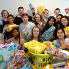 Students from the University of Otago's Te Rangi Hiroa College display Christmas presents they...