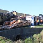 A logging truck ended up on its side after a collision with a train in Invercargill this morning....