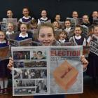 St Bernadette's School pupil Ruby de Graaf (10) reads a special election lift-out in yesterday's...