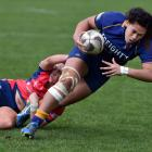 Otago second five-eighth Kilistina Moata'ane scores one of her five tries despite the effort of...