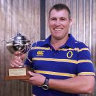 Otago rugby volunteer of the year recipient Hugh Tait with the award he received this week. Photo...