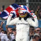 Lewis Hamilton celebrates his Formula One World Championship victory. Photo: Reuters
