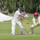 Otago nightwatch man Neil Wagner attempts to cut the ball while Canterbury wicket keeper Cameron...