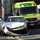 An ambulance attends a crash in Albany St, Dunedin, last night. Photo: Stephen Jaquiery