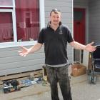 Craig Campbell in his now empty driveway after people in Balclutha took the opportunity to rehome...