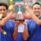 Yasutaka Uchiyama and Ben McLachlan hold the trophy for winning the Japan Open in Tokyo. Photo:...
