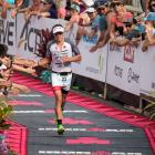 Braden Currie nears the finish line of the  Ironman world championships in Kona, Hawaii,...