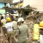 Rescue workers are seen following a building collapse in Bengaluru. Photo: ANI via Reuters