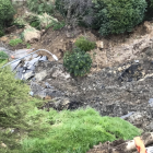 Some of the debris at the bottom of the bank shows a lamp-post and parts of the car park. Photo:...