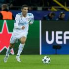 Real Madrid's Cristiano Ronaldo controls the ball during their Champions League match against...