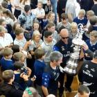 America's Cup minder Norman Newton is surrounded by pupils wanting one last glimpse and, if they...